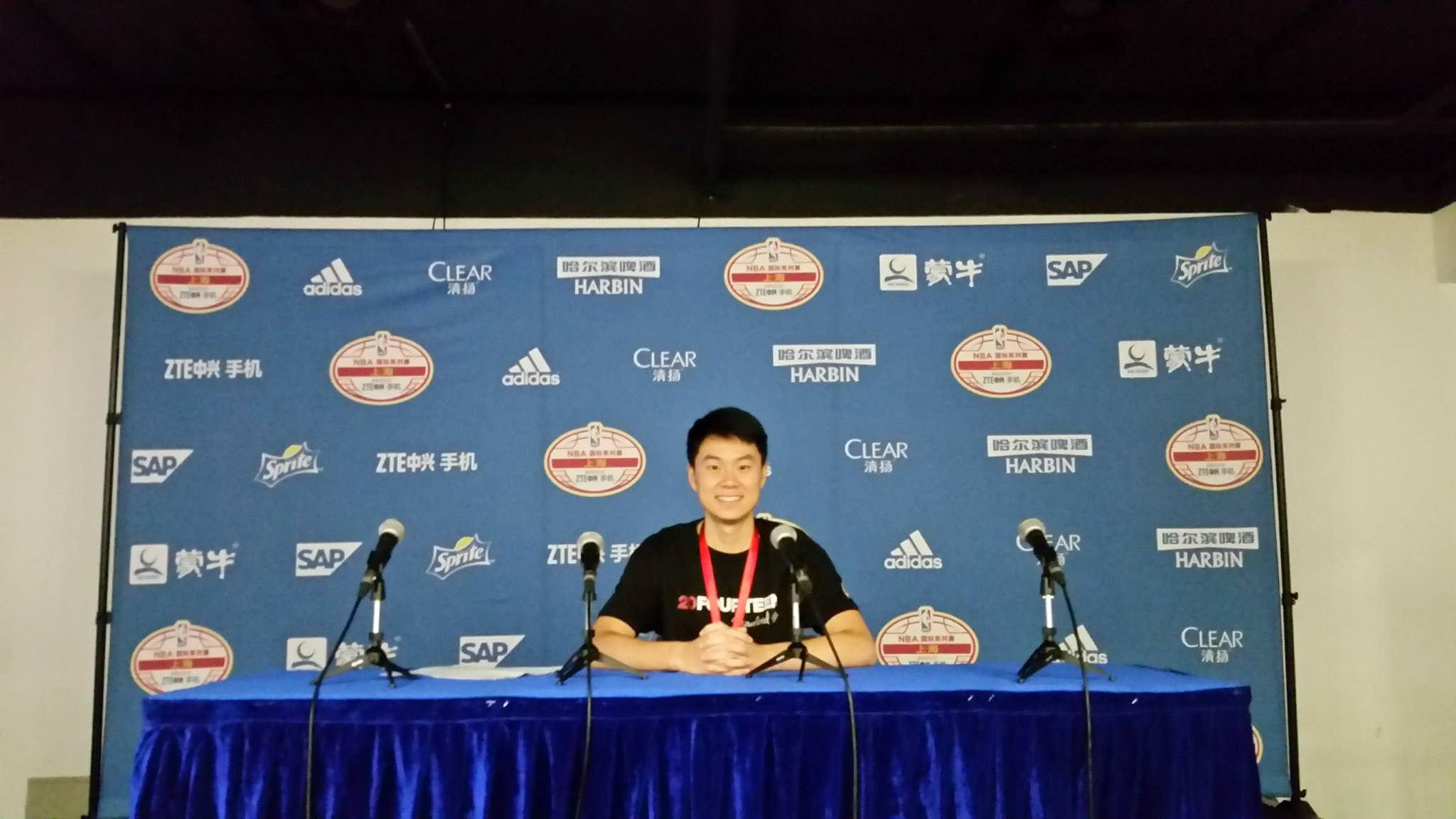 At the NBA Global Games press conference table in Beijing.
